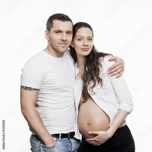 Pregnant couple isolated on white background