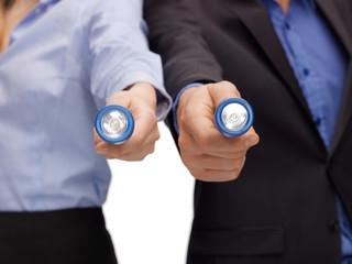 business team holding pocket flashlights