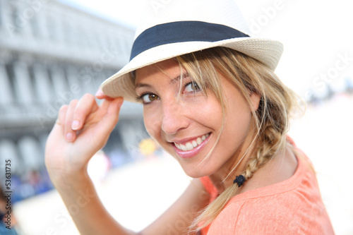 Portrait of beautiful blond girl with hat