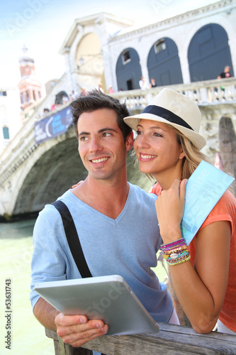 Couple in Venice standing in front of the Rialto bridge