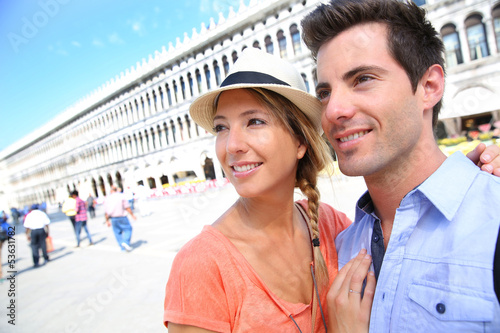 Couple of tourists in San Marco place in Venice