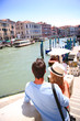 Couple in Venice looking at view of Canal grande