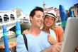 Couple in Venice standing in front of the Rialto bridge