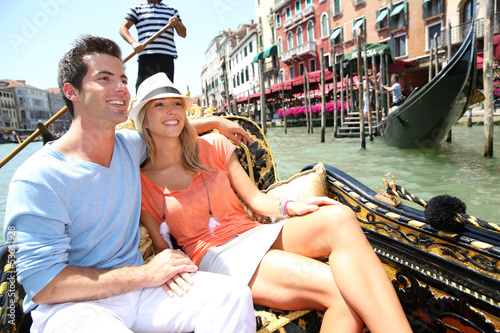 canvas print picture Couple in Venice having a Gondola ride on canal grande