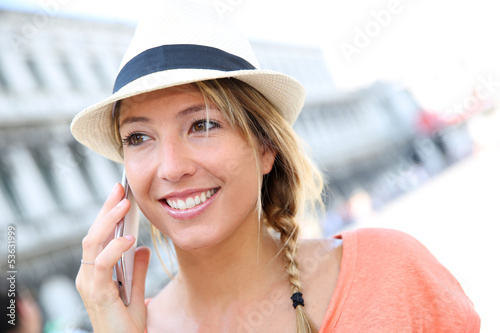 Portrait of beautiful girl talking on mobile phone