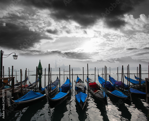 Foto op Aluminium Gondolas Venice with gondolas against sunrise in Italy