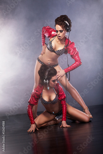Clubbing. Playful Funny Showgirls with Headphones in Clubwear