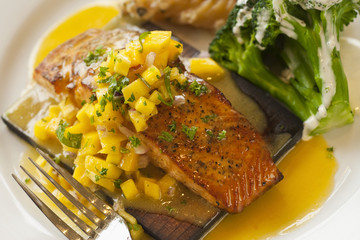 cedar plank cooked salmon with mango salsa
