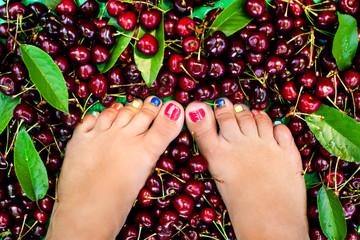 Female legs fresh summer berries