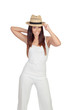 Attractive girl dressed in white with straw hat