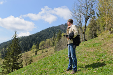 Man standing on a steep grassy slope