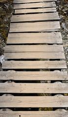 Rustic old wooden footbridge