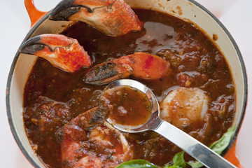 pot of crab cioppino with spoon