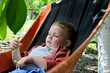 Small boy relaxing in a hammock