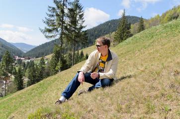 Man sitting on a steep mountain slope