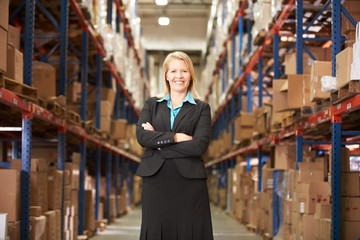 Portrait Of Female Manager In Warehouse