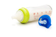 baby bottle and blue pacifier with clipping path
