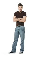 young man full body in jeans a white background