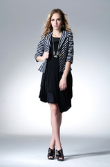 Full length fashion woman in fashion dress posing