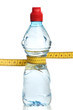 Bottle with water and a measuring tape isolated