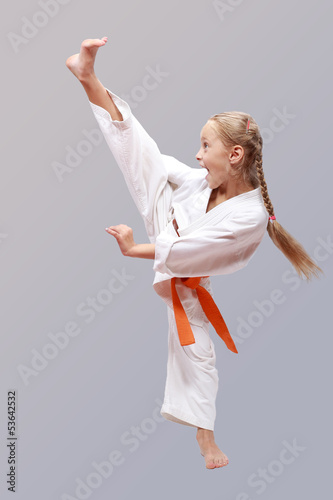 Professional girl does karate kick