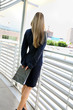 young businesswoman standing in the office buildings