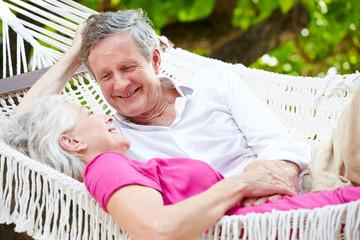 Senior Couple Relaxing In Beach Hammock