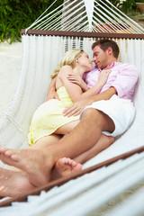 Couple Sleeping In Beach Hammock
