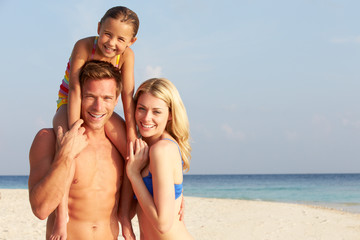 Portrait Of Family On Tropical Beach Holiday