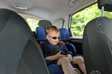 Little boy in car