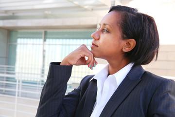 Pretty african businesswoman thinking