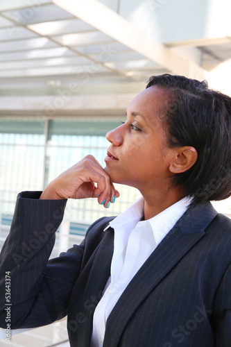 Pretty african businesswoman thinking