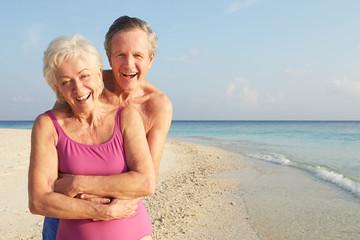 Portrait Of Senior Couple On Tropical Beach Holiday