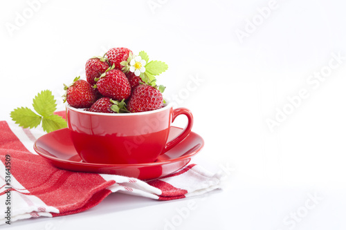 Strawberries in red cup