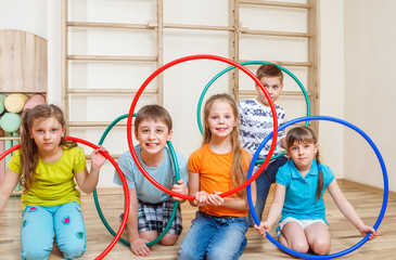 Kids holding hula hoops