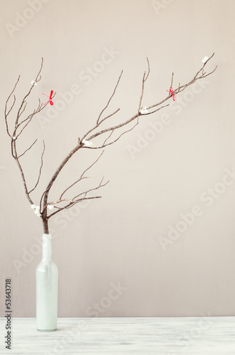 Bare branch in white vase on table top, interior decoration