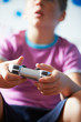 Boy Holding Controller Playing Video Game