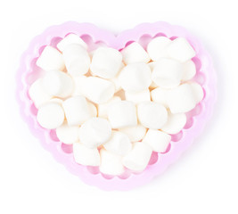 White Fluffy mini Marshmallow in heart shape on white background