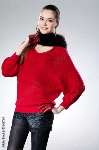 portrait of young woman with scarf posing