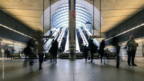 Commuters inside Canary Wharf Station in London. - 53648310