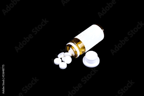 Suplements pills on the table with dose