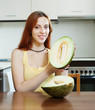 woman with ripe melon in home