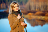 Blond woman against an autumn nature landscape