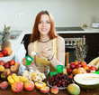woman cooking fruit salad with yoghurt