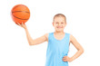 Smiling child holding a basketball