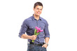Smiling guy holding flowers and looking at camera