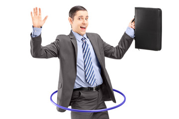 Young businessman in suit holding a briefcase and dancing