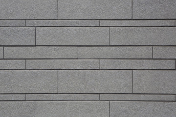 Muro grigio di mattoni irregolari