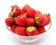 Ripe strawberry in the bowl isolated on white