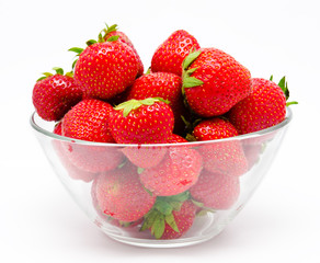Red strawberry in the bowl isolated on white